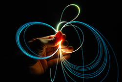 photo of fiber optic cables in a human hand